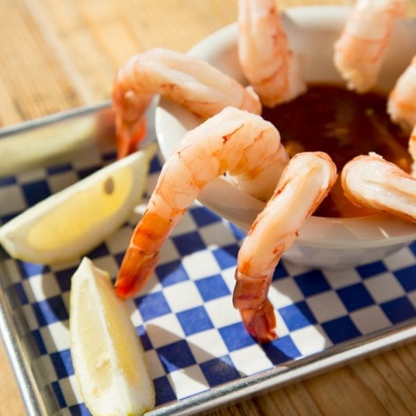 shrimp in cocktail sauce with lemon